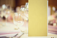 Served table with menu brochure in restaurant, closeup. Free space for your text or information.  Stock Photo