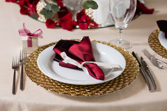 Served table with napkins, cards and glasses Royalty Free Stock Photo