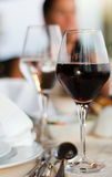 The served table with red wine at restaurant. (shallow dof stock images