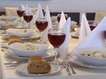Served table with red wine at restaurant Royalty Free Stock Photos