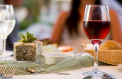 The served table with red wine at restaurant stock photography