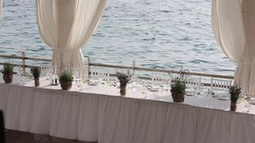 Served table in a restaurant on the beach in Europe at sunset stock video footage