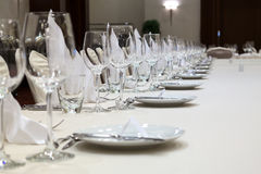 Served table in a restaurant. Fine table setting in gourmet restaurant (close-up). Focus in the center Stock Photo