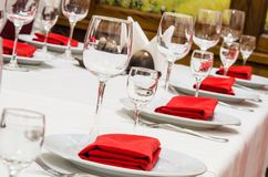 Served table with glasses, cutlery and napkins Stock Images