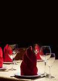 Served table in restaurant with red napkins Stock Photos
