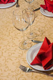 Served table in a restaurant with a tablecloth, napkin, wine glasses Stock Image