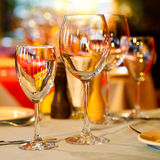 Served table in a restaurant. Wine glasses. shiny, romantic interior Stock Photos