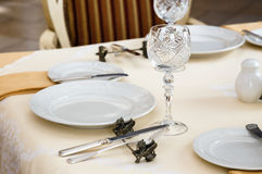Served table in retro luxury hotel restaurant close up Royalty Free Stock Photos