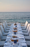 Served table on the sea shore Stock Photography