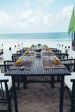 Served table at the sea shore on tropical beach. Served table at the sea shore in tropical resort beach Royalty Free Stock Image