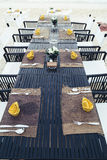 Served table at the sea shore on tropical beach. Served table at the sea shore in tropical resort beach Royalty Free Stock Photos