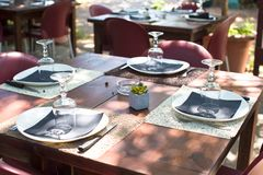 Served table set at outdoor cafe. Outdoor served cafe in european city on summer time Stock Images