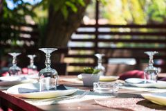 Served table set at outdoor cafe. Outdoor served cafe in european city on summer time Stock Photos