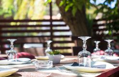 Served table set at outdoor cafe Stock Images