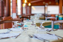 Served table set at restaraunt in the evening Stock Image