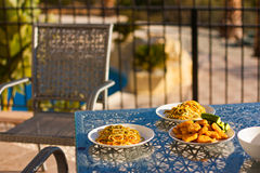 Served table set at summer terrace. View stock photography
