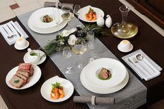 Served table. With shrimps and meat dishes stock photography