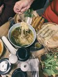 Served table top view, dinner. People eat food together, woman`s hand, pours soup, dinner, lunch together, family. Friends eat, cuisine of different nations stock image