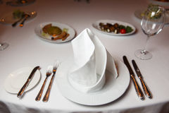Served table with white tablecloth. Photo of served table with white tablecloth , napkin Stock Photos