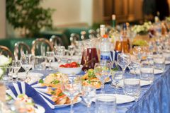Served tables at the Banquet. Drink, alcohol, delicacies and snacks. Catering. A reception event Stock Image