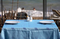 Served tables in beach restaurant Royalty Free Stock Photos