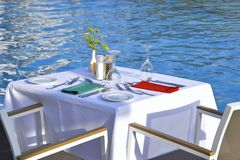 Served tables of the restaurant on the beach stock image