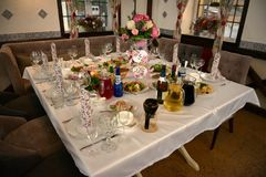 Served tables in restaurant for wedding reception royalty free stock images