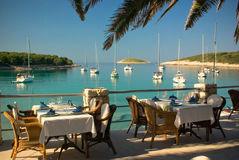 Served tables at yachting club beach restaurant Royalty Free Stock Images