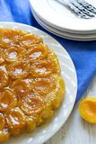 Served tart Tatin with apricots Royalty Free Stock Image