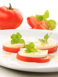 Served tomato with mozzarella and basil Royalty Free Stock Photos