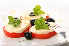 Served tomato with mozzarella and basil Stock Image
