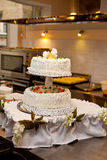 Served two stair wedding cake for a banquet. Table in the kitchen Stock Photo