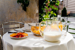 Served vegetarian breakfast table in the courtyard Stock Photography