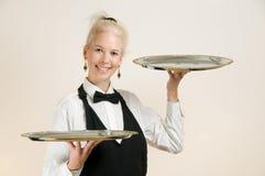 Serveerster met Dienbladen Royalty-vrije Stock Afbeeldingen