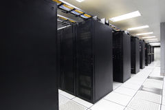 Server. Several racks of 1u and 2u servers in black cabinets in a computer operations room Royalty Free Stock Photography