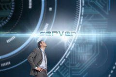 Server against futuristic technological background. The word server and smiling businessman with hands on hips against futuristic technological background stock photos