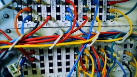 A server with colored cables, close up. White equipment with many cables stock video