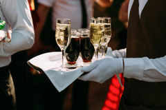 Server with the different alcohol drinks Royalty Free Stock Photos