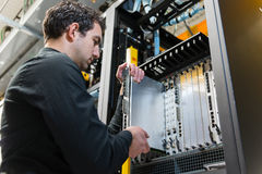 Server expansion. IT staff installing a new server Stock Image