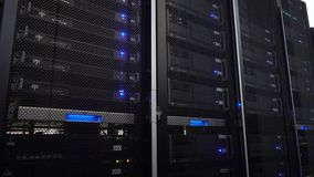 Server rack cluster in a data center. Moving camera. 4K. Server rack cluster in a data center. Moving camera. 4K stock video