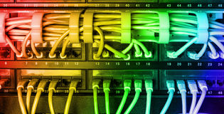 Server rack with rainbow internet patch cord cables Royalty Free Stock Photos
