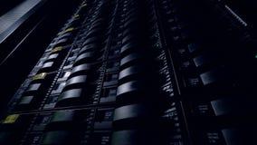 Server racks working in dark at a network data center, render farm. 4K. stock video