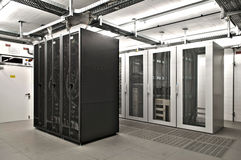 IT Server room. Air conditioned it server room with cable bars double bottom for high available servers Royalty Free Stock Photos