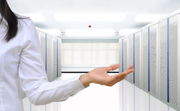 Server room. Working woman in the communication and internet network server room Stock Photo