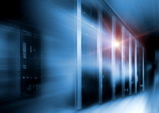 Server room in dark, with blue colored lights motion Royalty Free Stock Images