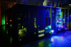 Server room in the dark, with bright colored lights Stock Image