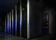 Server room in dark, with bright colored lights motion Royalty Free Stock Photos