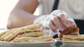 Server serving sandwich for client lunch stock video
