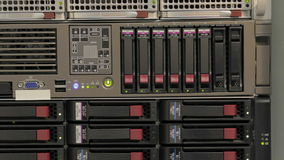 Server stack with hard drives. Blinking LEDs of server stack with hard drives in a datacenter