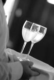 Server with wine glasses Stock Images
